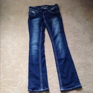 Boot cut back with faded wash on thighs